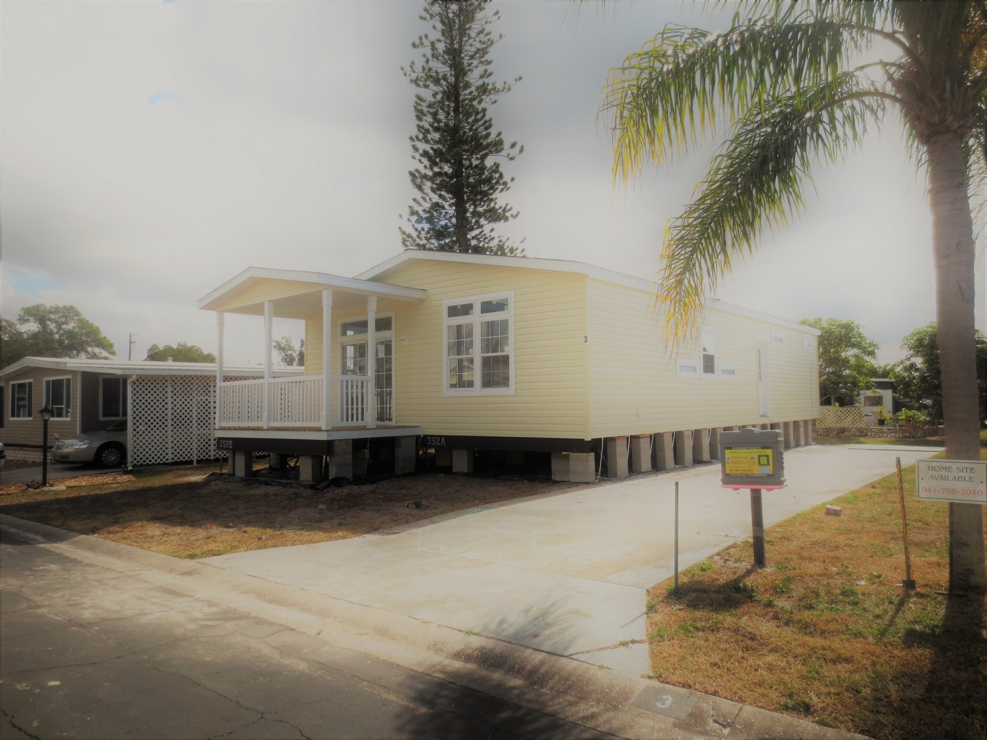 """New """"Manatee Jacobsen"""" mobile home is up on pilings."""