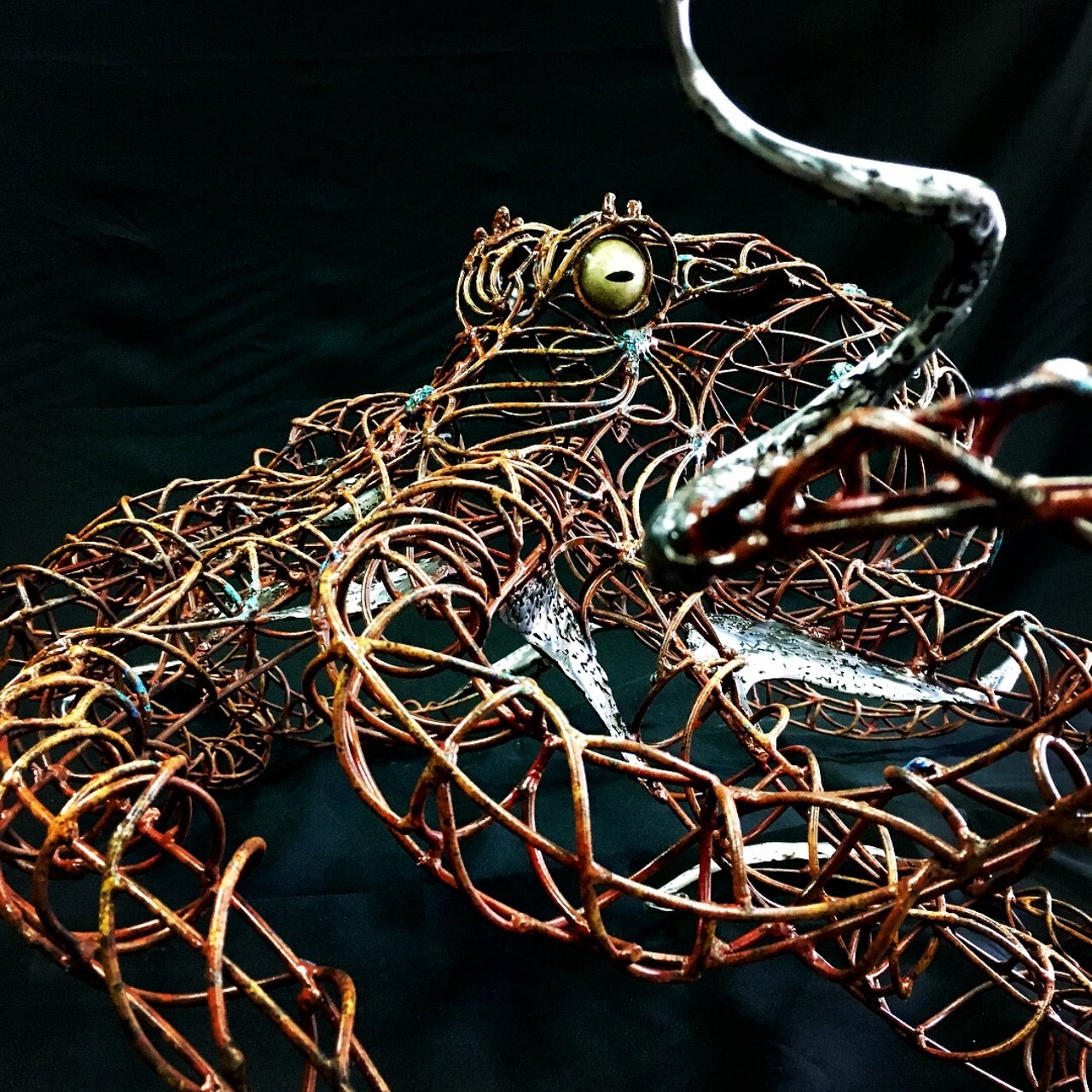 Steel octopus sculpture, acrylic paint by Rusty Croft.