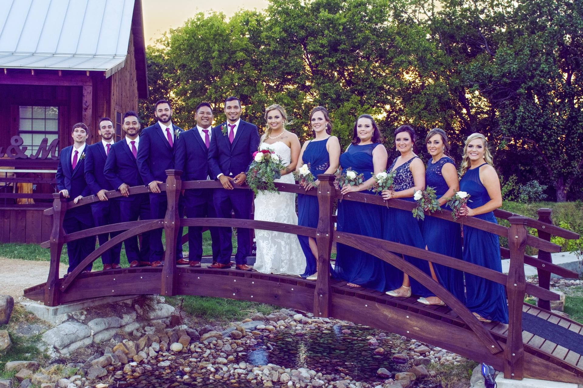 bridge cowboy west style farmer launch group wedding photo