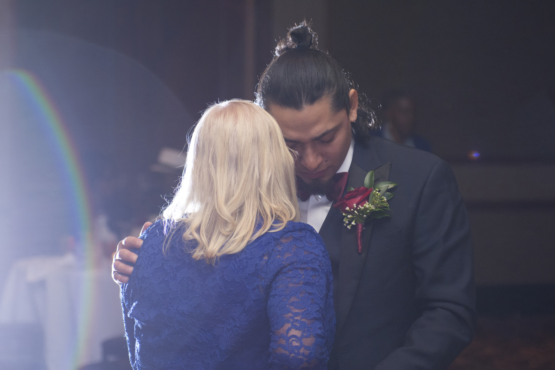 touching sweet moment when groom dance with mother mom cry , wedding dancing party