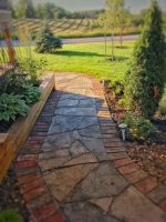 Stirling Ontario red brick and grey flagstone walkway with field in the background