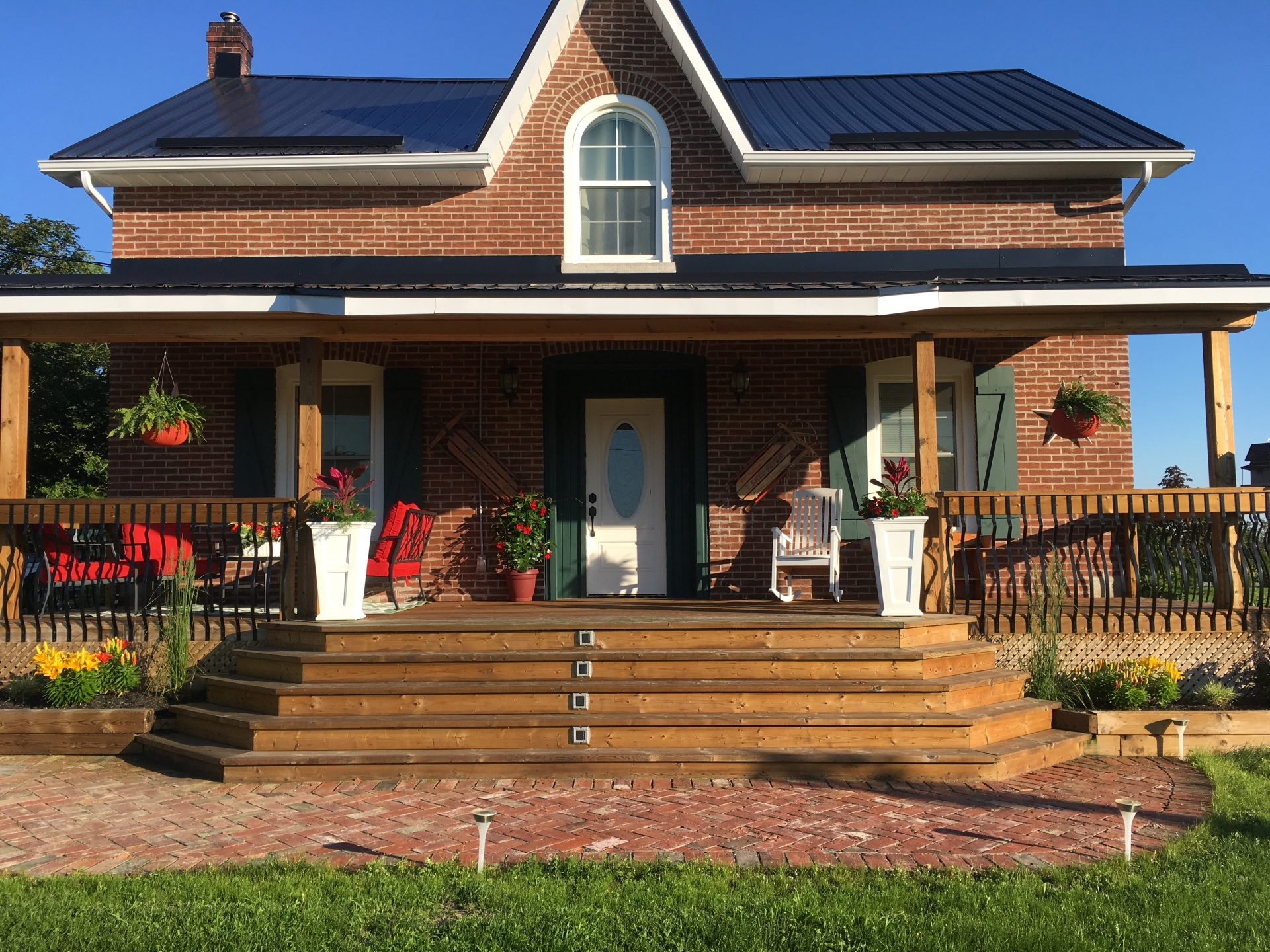 Stirling Ontario Farmhouse landscaping with red brick landing