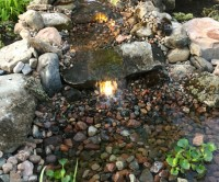 Waterfall without the maintenance of a pond, garden design, Lavish