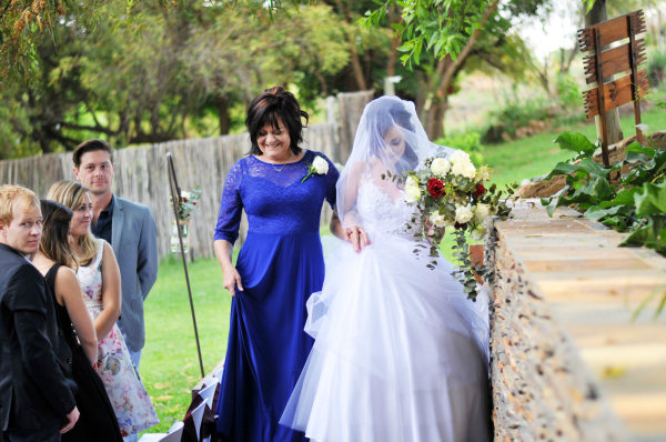 Samantha and her mother walking towards the aisle
