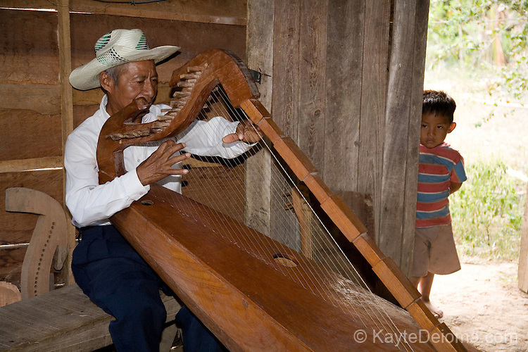 cuajb'aank - to play music;  play an instrument (marimba, harp, guitar, etc)
