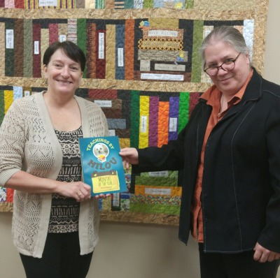 """Mommy donating our 1st book """"Months of the Year"""" to the Bathurst Public Library,"""