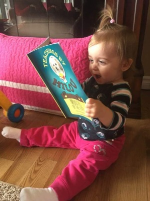 Warms Mommy's & my heart to see a little one enjoying our book.