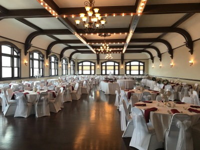 The ballroom rental includes round tables with chairs seating 275 comfortably.
