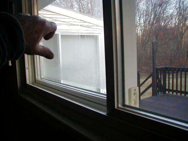Window,rear bedroom,fogged