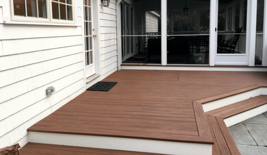 LuciGold lightweight all aluminum basement bulkhead door hidden under wooden patio, porch or deck