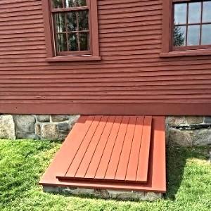 LuciGold lightweight all aluminum basement bulkhead door.  custom colors. sloped stone foundation