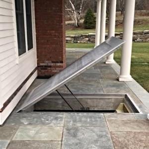 LuciGold lightweight all aluminum basement bulkhead door, flat hatch system under stone patio