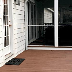 LuciGold lightweight all aluminum basement bulkhead door hidden under wooden porch