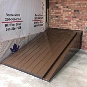 LuciGold lightweight all aluminum basement bulkhead door. Inside corner installation