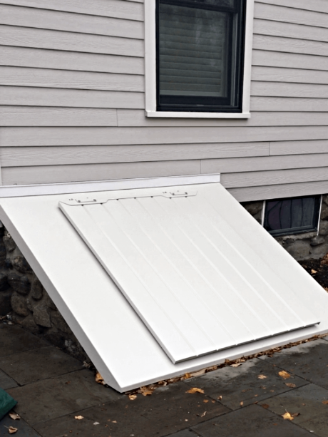 LuciGold lightweight all aluminum basement bulkhead door custom designed for high sloped stone foundation