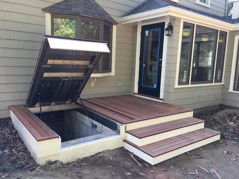 LuciGold lightweight all aluminum basement bulkhead door hidden under wooden patio, porch or deck in the open position