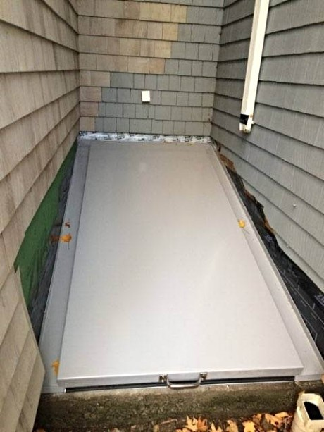 LuciGold lightweight all aluminum basement bulkhead door custom designed for double inside corner