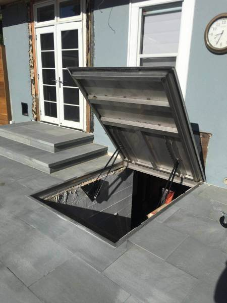 LuciGold lightweight all aluminum basement bulkhead door, flat profile hatch on stone patio