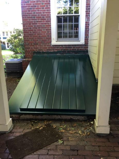 LuciGold lightweight all aluminum basement bulkhead door custom designed for high slope foundation