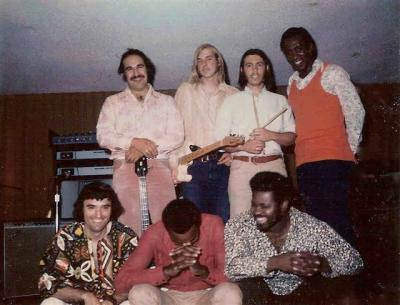 L to R (top row):  Iggy Perez (bass); Mark Manroe  (guitar): Mike Morrison (drums); and Ed Burke (keyboards). L to R (bottom row): Ray Baradat (vocal-guitar); Syl (vocals); and  Johnny Johnson.