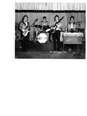 (L. to R.) Pete Escobedo,   Bass guitar; Louie Gonzales, Drums; Albert Delgado, Lead guitar;   and Martin Montelongo, Keyboards.