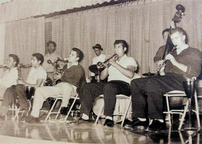 "L to R: Freddie Rodriquez (guitar); Art ""Tootie"" Rodiquez (guitar); Louie Fernandes (sax); Unknow member; Henry Vaquez (sax - bass - trombone); Unknown member; Ray Martinez (percussion); and in back Manuel Garcia (drummer)."