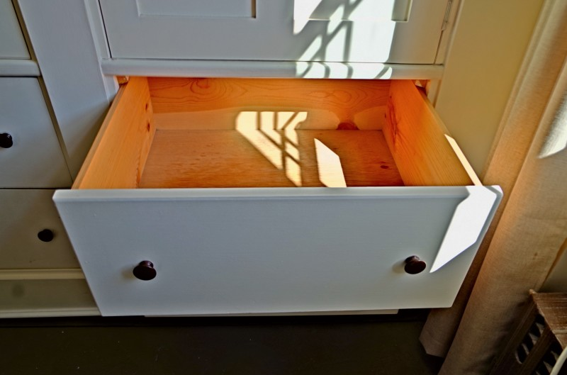 One of six extra deep built in drawers