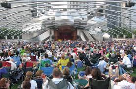 people sitting at a concert at pritzker pavilion in millennium park Chicago