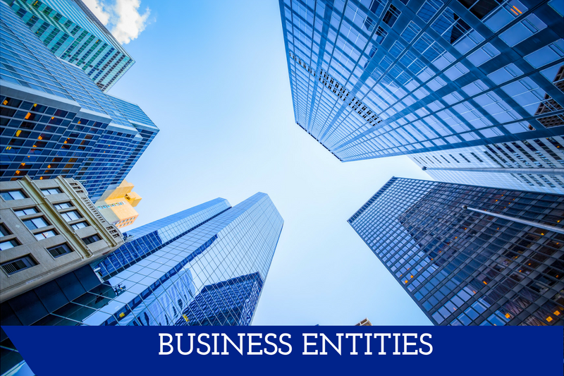 """A picture facing up towards the sky as skyscrapers reach up.  A banner reads """"Business Entities."""""""