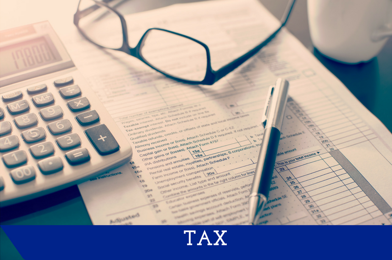 """An image of a tax form with a pen and calculator sitting by it.  A banner at the bottom reads """"Tax."""""""