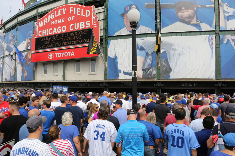 people standing outside of Wrigley field