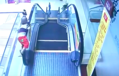 The baby stuck his hand on the escalator and fell down