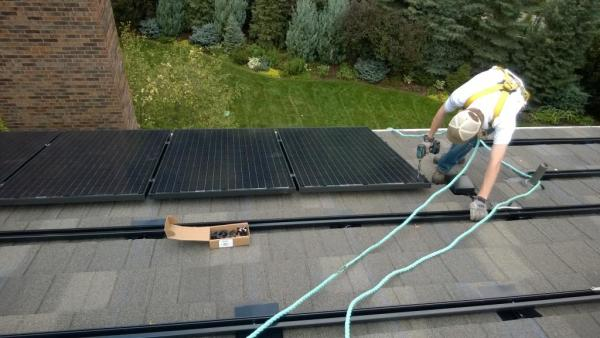 Installing Solar Panels On A Residential Rooftop In Northern Colorado