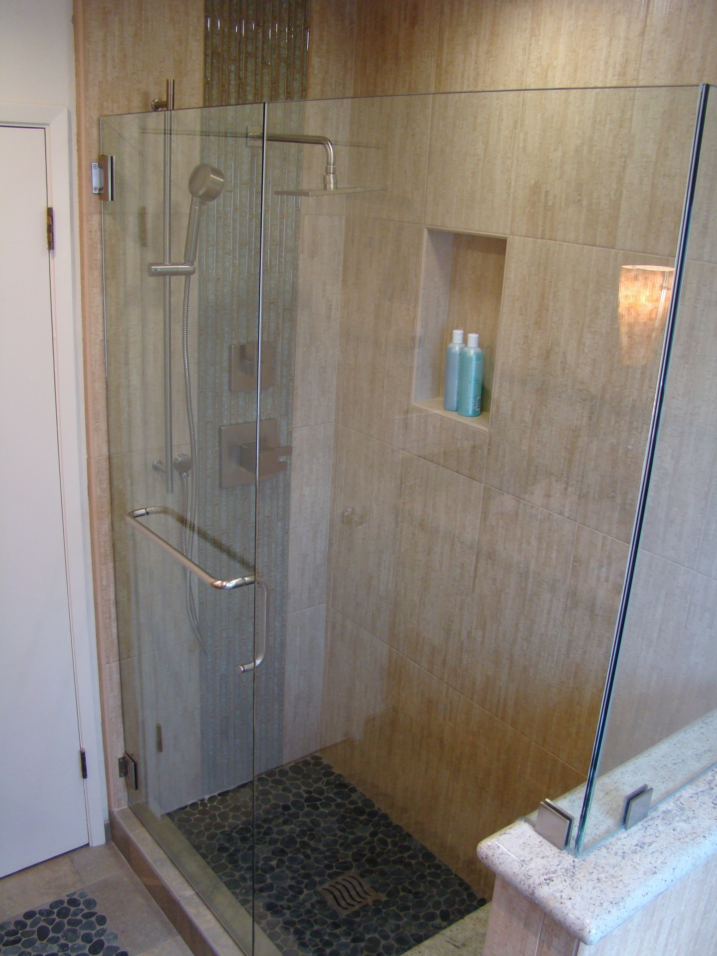 Fiorito Interior Design, interior design, remodel, bathroom, tropical, shower, pebble shower pan, crackle glass mosaic, modern shower head, niche