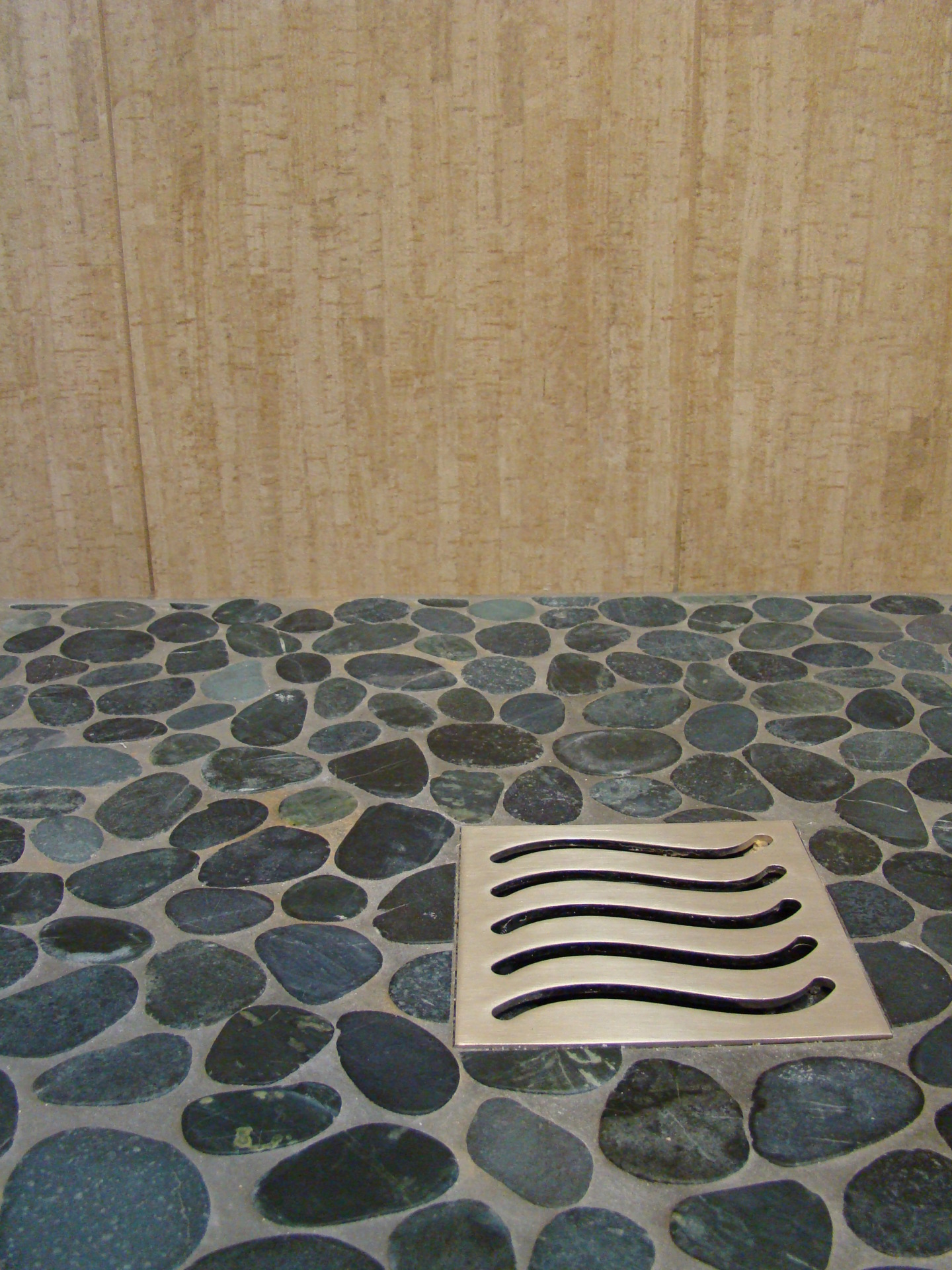 Fiorito Interior Design, interior design, remodel, bathroom, tropical, shower, pebble shower pan, wave drain cover