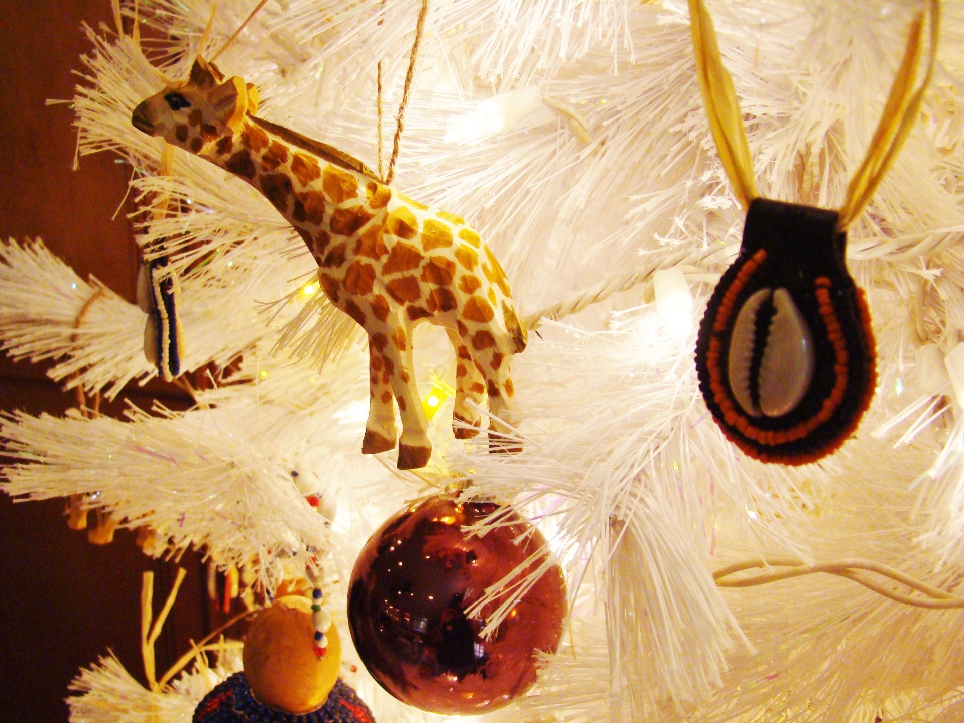 Fiorito Interior Design, interior design, Homes For The Holidays, African, holiday tree, carved wooden giraffe ornament, cowrie shell ornament
