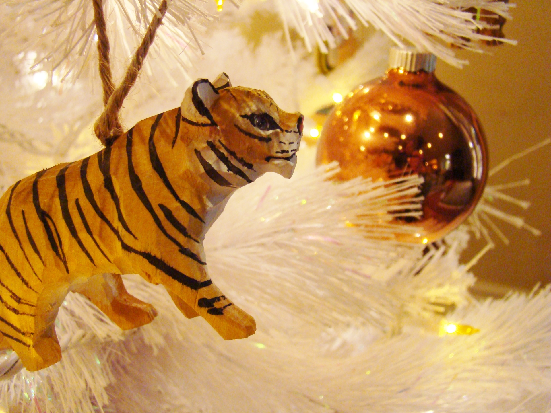 Fiorito Interior Design, interior design, Homes For The Holidays, African, holiday tree, carved wooden tiger ornament