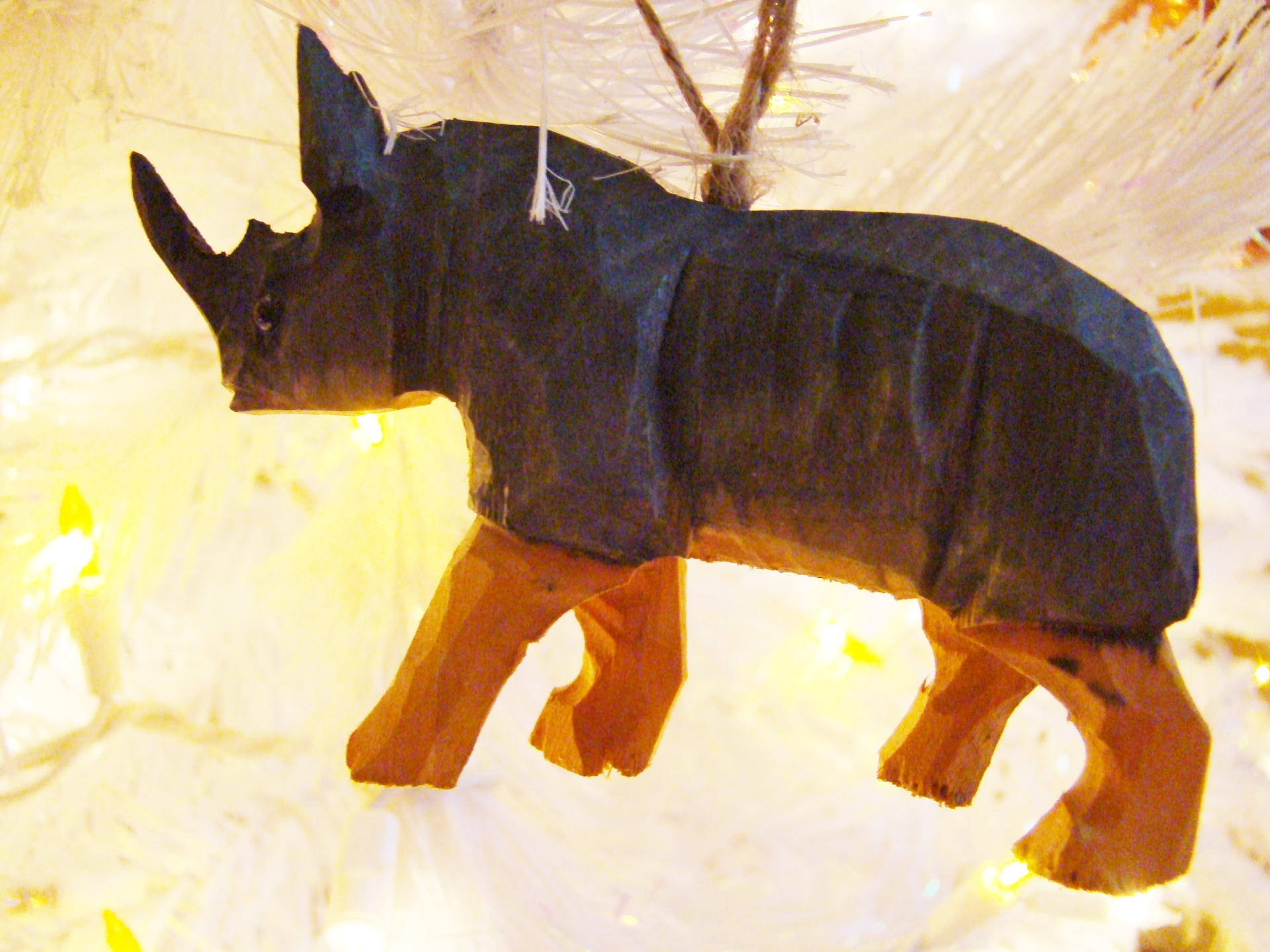 Fiorito Interior Design, interior design, Homes For The Holidays, African, holiday tree, carved wooden rhino ornament
