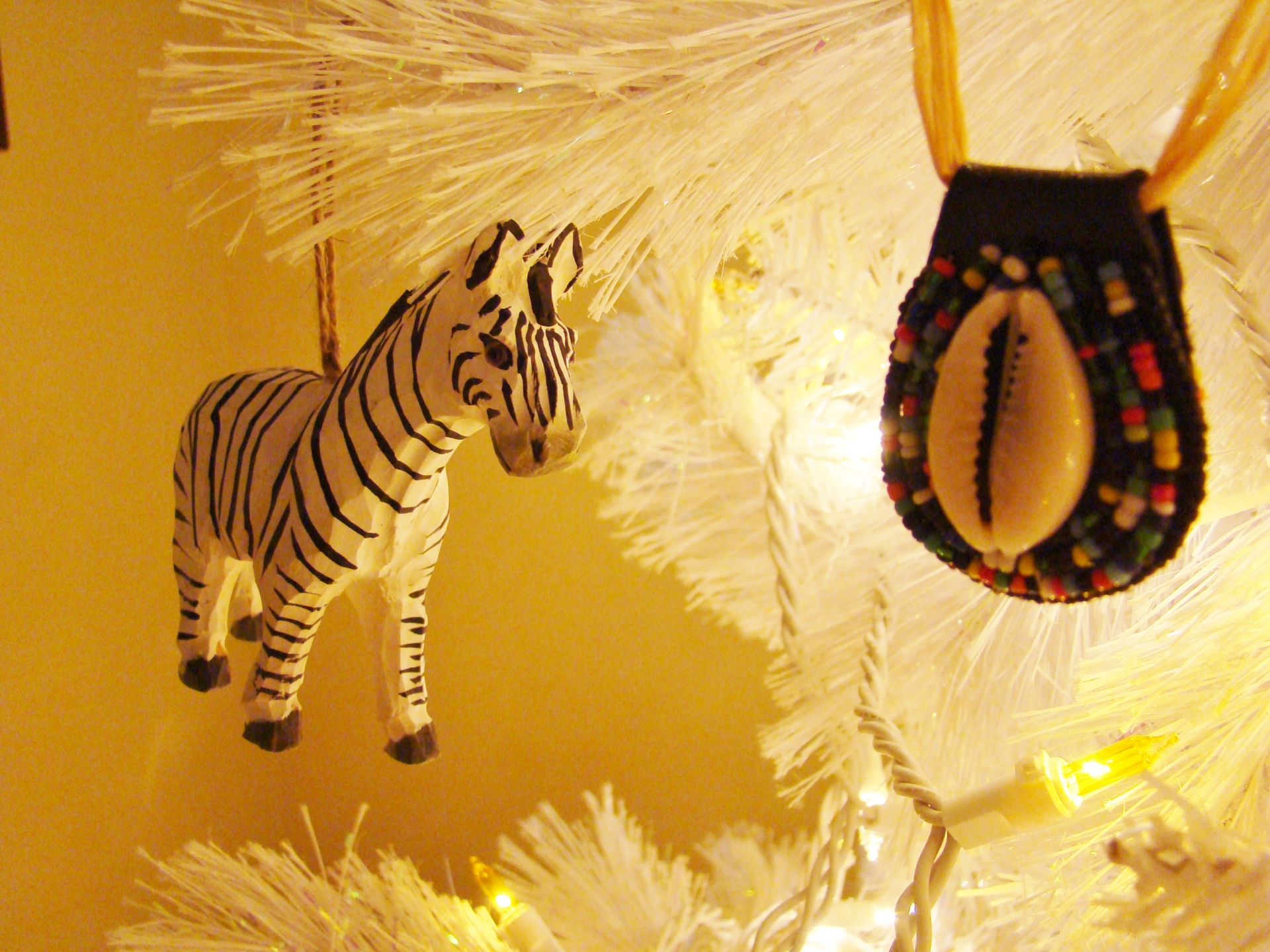 Fiorito Interior Design, interior design, Homes For The Holidays, African, holiday tree, carved wooden zebra ornament, cowrie shell ornament