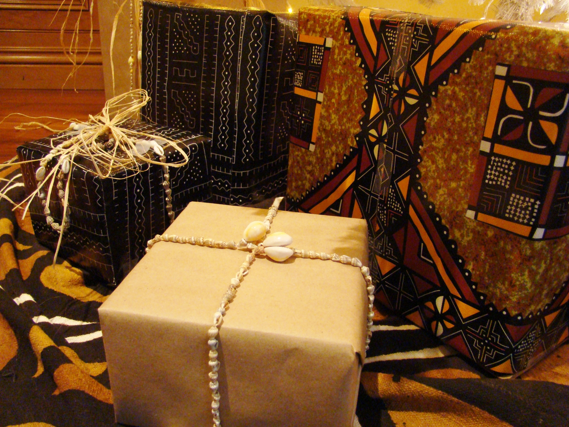 Fiorito Interior Design, interior design, Homes For The Holidays, African, holiday tree, African design wrapping paper, cowrie shells, mud cloth, bògòlanfini