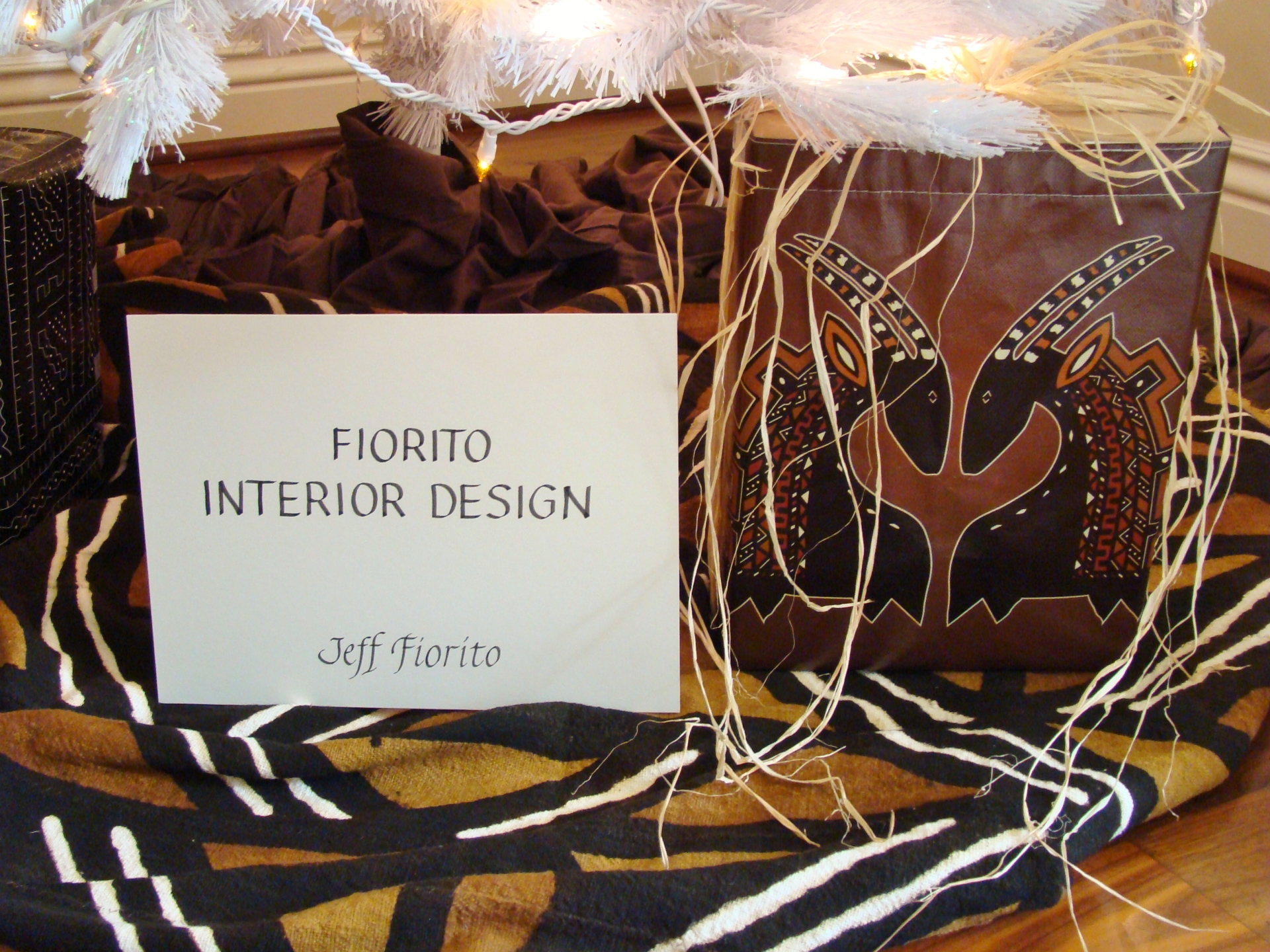 Fiorito Interior Design, interior design, Homes For The Holidays, African, holiday tree, African design wrapping paper, raffia, cowrie shells, mud cloth, bògòlanfini