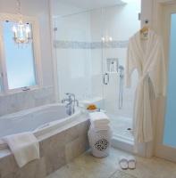 Fiorito Interior Design, interior design, remodel, master bathroom, white and grey, tub, shower, marble floor, basketweave, chandelier