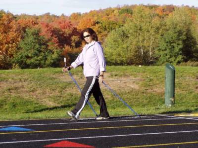 Fitness Walking on outdoor track with SWIX Nordic Walking Poles