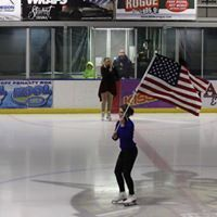 Saluting the flag at a show.