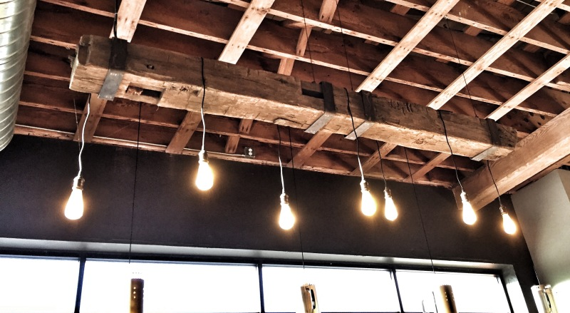 wood beam, light fixture, rustic, edison bulbs
