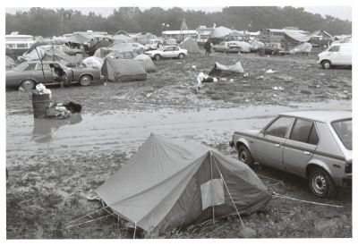 Cars and camping tents in mud