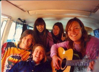 People inside a VW bus playing Guitar