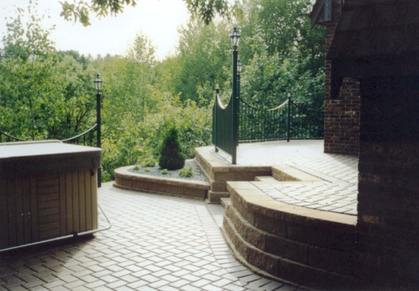 Block Retaining Wall, Custom Wrought Iron Fence and Paver Patio