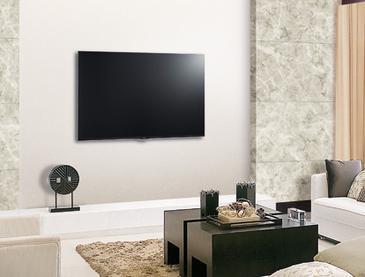 tv installation on wall in living room