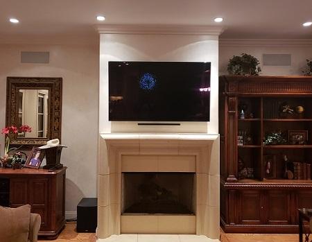 TV mount service over fireplace in newport beach